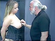 Busty brunet babe in corset gets throat fucked and gags on cock