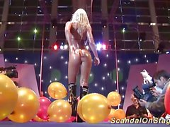 Busty milf sex show on public stage