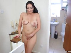 Stripping and dancing British milf with incredible curves