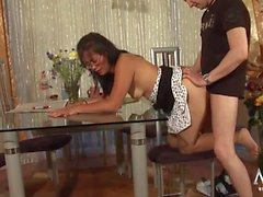 Milf in a polka dot skirt fucked over a table