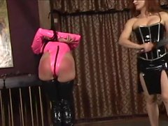 Lesbian bdsm girls in pink and black latex whip, spank, and torture young slave