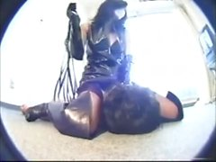Japanese mistress in mask, leather gloves and boots
