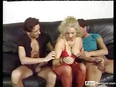 Curly-haired blonde MILF gets the loving attention of two young men