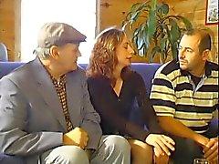 Flirty woman sucks two mature cocks in threesome fun