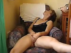 Kinky mature masturbates in the home