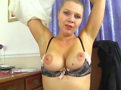 Sensual blonde milf in a sheer blouse and lingerie
