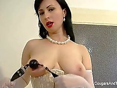 MILF demonstrates how to tie up a brunette