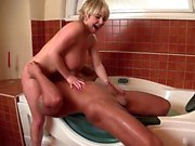 Sandra Boobies is soaking in the tub when her boyfriend...