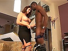 Busty white MILF sucking on giant black cock