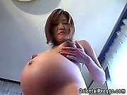 Pregnant asian milf naked and showering