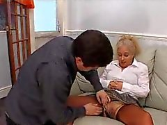 Seamed stockings milf uses a toy on pussy