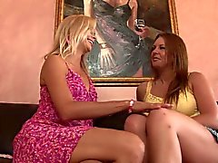 Brunette MILF gets fucked by blonde slut using a toy