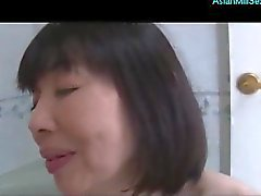 Mature Asian Woman Giving Blowjob In The Bathroom