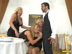 Three blonde MILFs molest then fuck their waiter