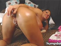 Horny MILF toys and fists her ass