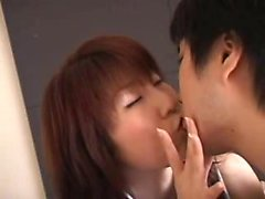 Seductive Japanese beauty with marvelous big boobs kisses a
