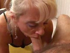 Blonde milf gives big dick a BJ