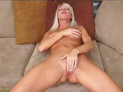 Blonde milf beauty gropes her tits and masturbates