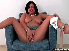 Older woman in white panties and pantyhose masturbates