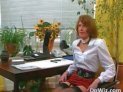 Awesome MILF in stockings blows two hard cocks