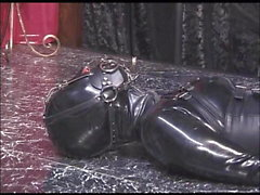 girl tied in latex rubber hooded gagged played by master