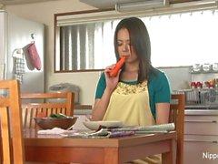 Asian MILF masturbates with a carrot