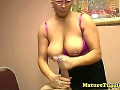 Mature spex mama tugging hard cock