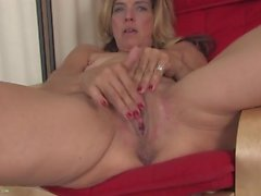 Tiny tits milf turns on her wet pussy
