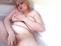 Fat blonde MILF lady masturbates in her bathroom