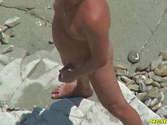Hot Milf masturbates at the beach while hubby watches