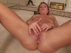 Milf on the carpet rubbing her beautiful clit