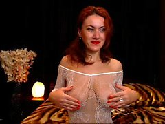 Smiling redhead milf is appearing mesh in a see-through!