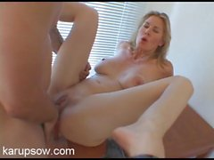 Naked milf bent over a table and drilled