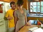 Horny milf fucks a younger guy in her kitchen