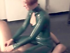 Stern redhead dominatrix trampling on her sub