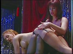 Brunette whore spanks the blond babe's ass
