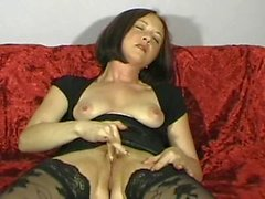 Lovely brunette milf rubs out two orgasms on cam
