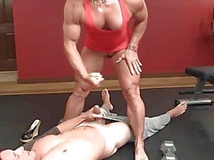 muscle woman pulls up her mini dress and rides