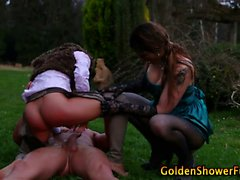 Outdoor goldenshowers threesome