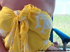 Blonde MILF Sun Bathing....