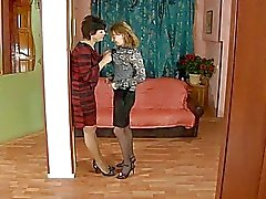 Mature brunette and young blonde in stockings fingering each other