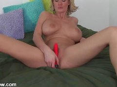 Her fake milf tits are hot as she plays with toys