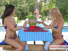 Stunning bikini MILF muffdived by lezzy teen