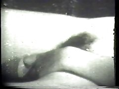 Kinky brunet deepthroats a thick white cock in classic porn