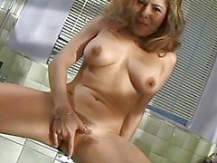 Milf plays with her warm slot