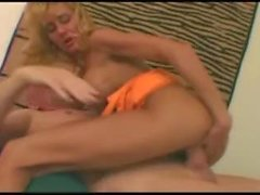 Slim blonde milf with great big fake tits