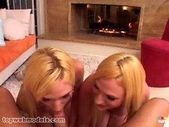 Twin sisters take turns sucking dick