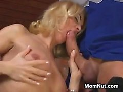 Blonde MILF With Small Fake Breasts