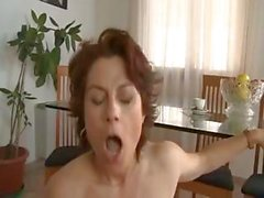 Curvy Italian mature redhead swallows his cock and gets pounded