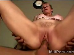Mature MILF mounts young hard prick in reverse cowgirl